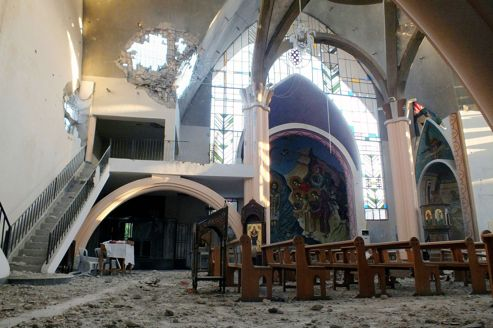 Debris is seen on the floor of Im Al-Zinar church that was damaged during clashes between Syrian Rebels and the Syrian Regime in Bustan al Diwan, Homs